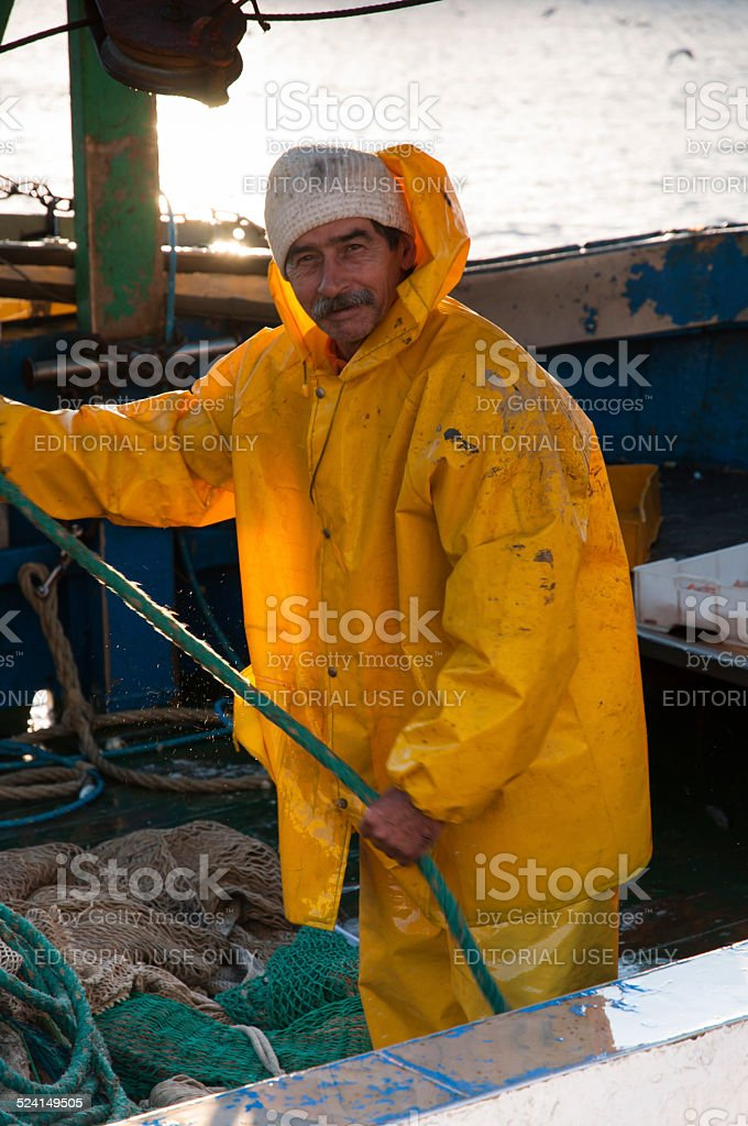 Traditional fisherman on the boat stock photo