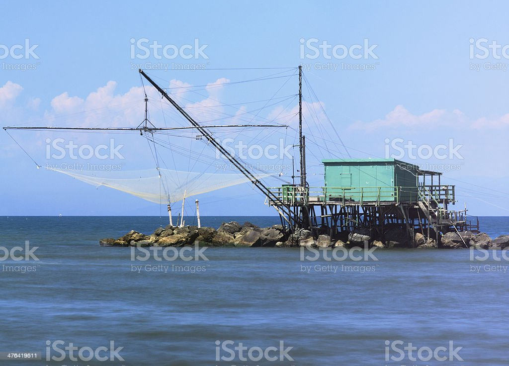 Traditional fishery activity at the river's mouth stock photo