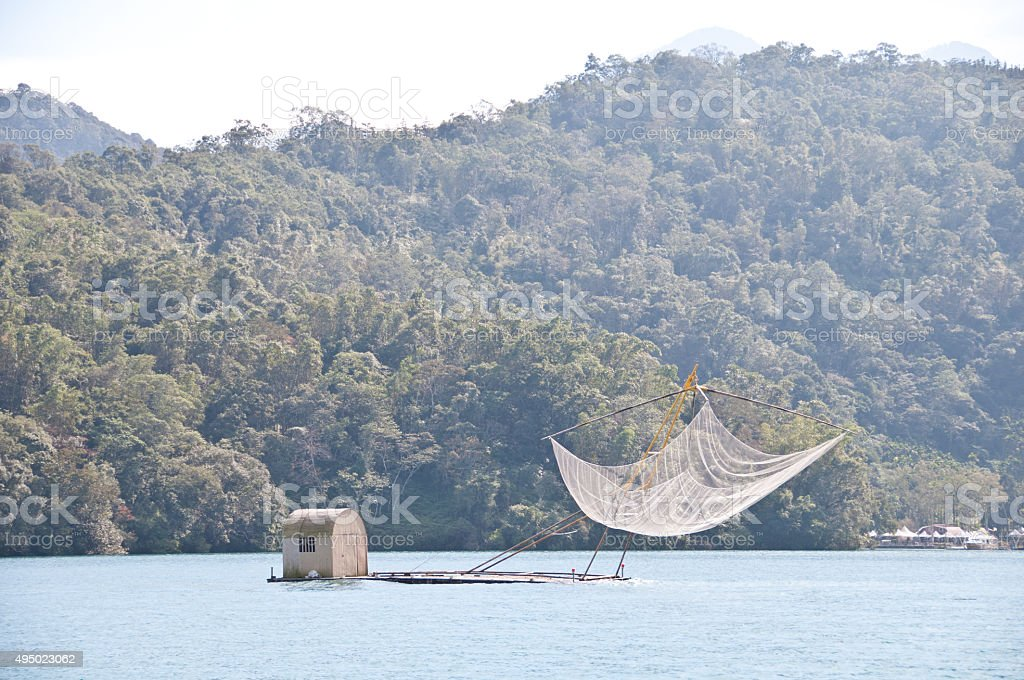 Traditional fishing boat in a lake stock photo
