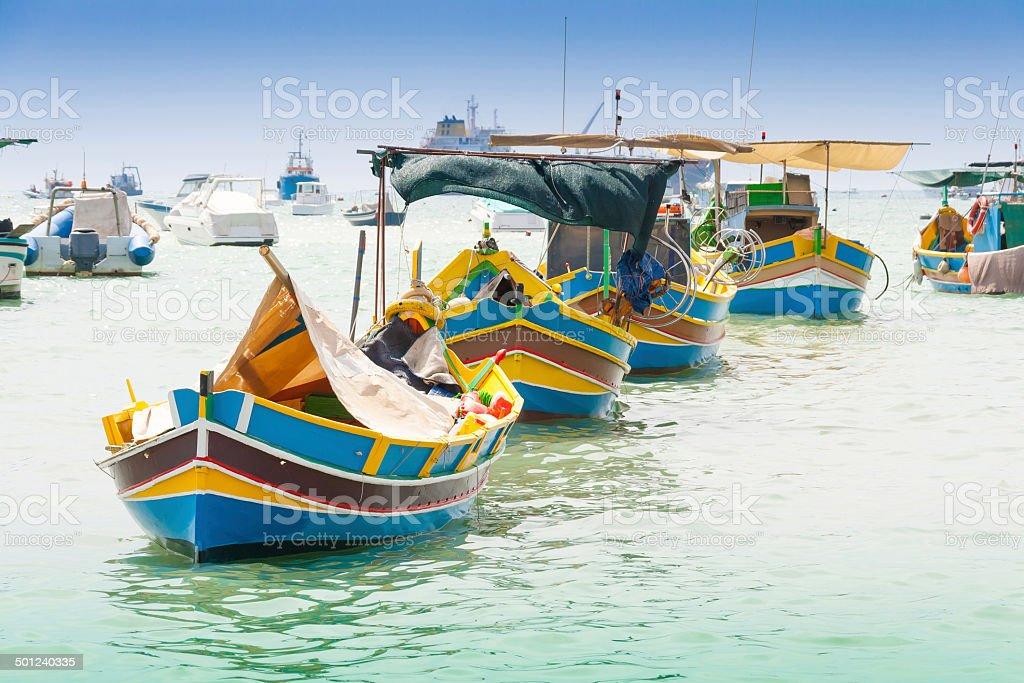 Traditional fishing boat (luzzu) in Marsaxlokk, a fishing villag stock photo