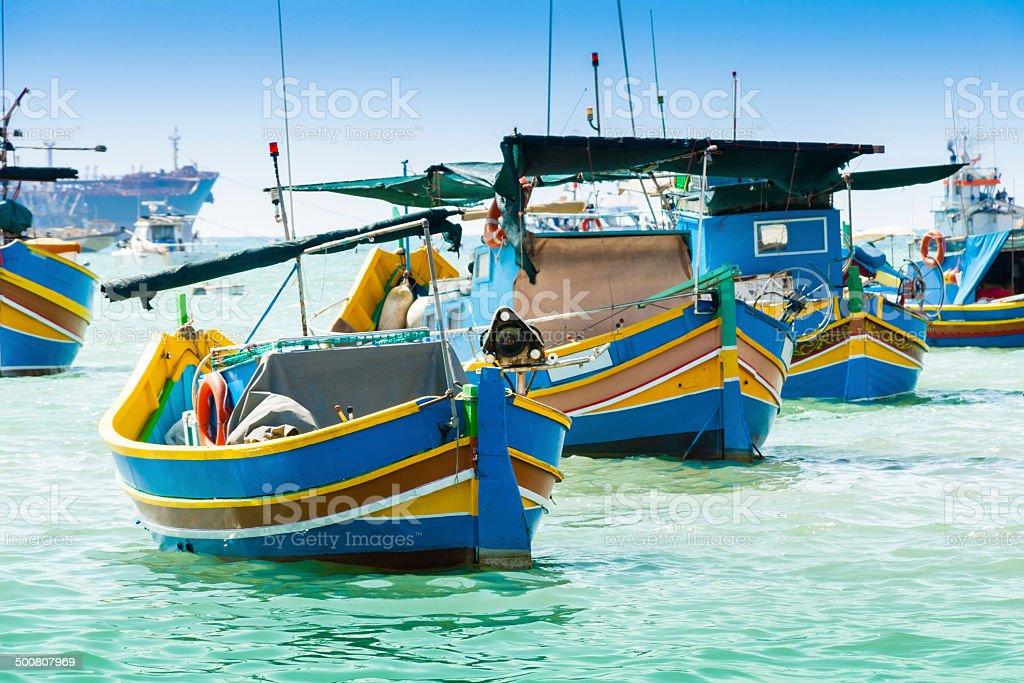 Traditional fishing boats in Marsaxlokk, Malta stock photo