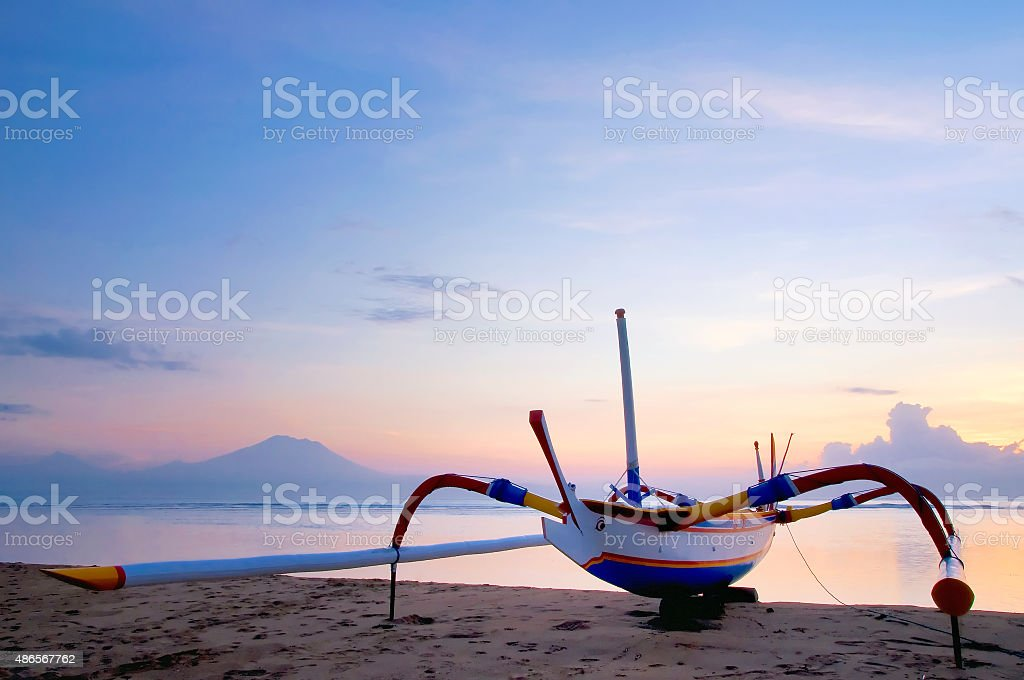 Traditional fishing boats in Sanur beach on Bali. Indonesia stock photo