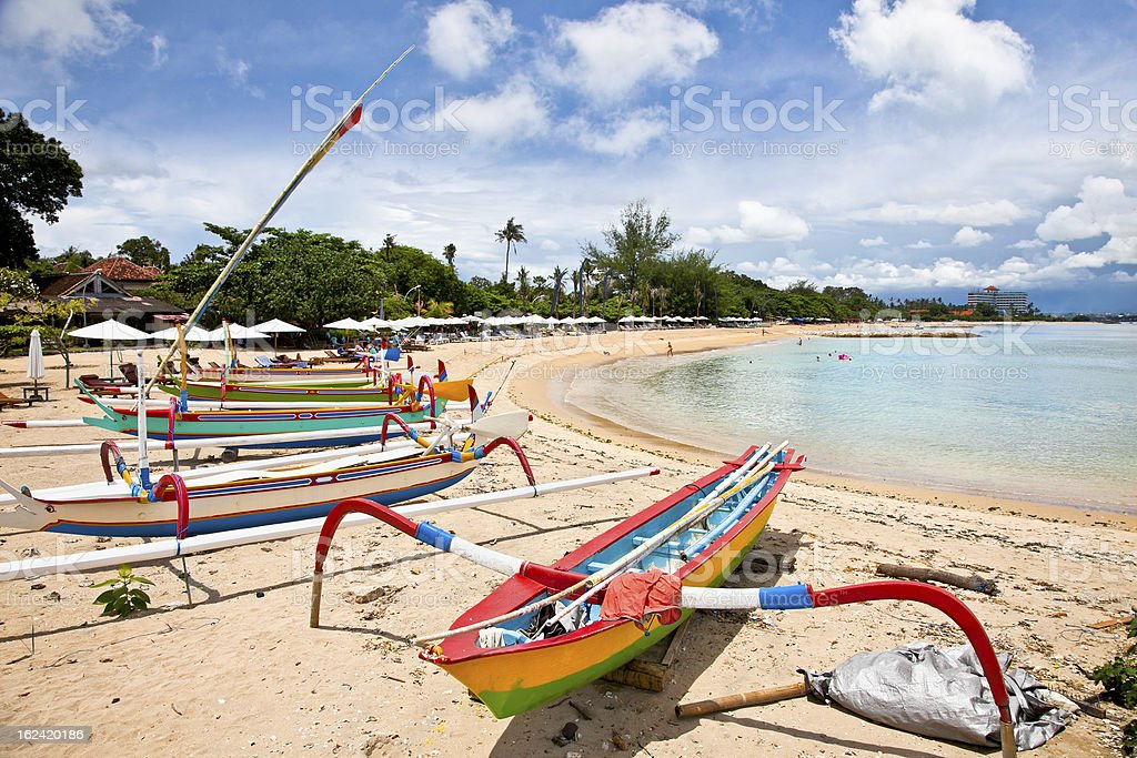 Traditional fishing boats on a beach in Sanur , Bali stock photo