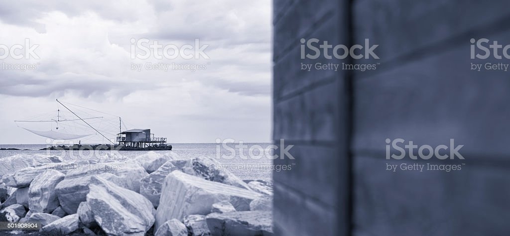 Traditional fishing house in Marina di Pisa - with copyspace stock photo