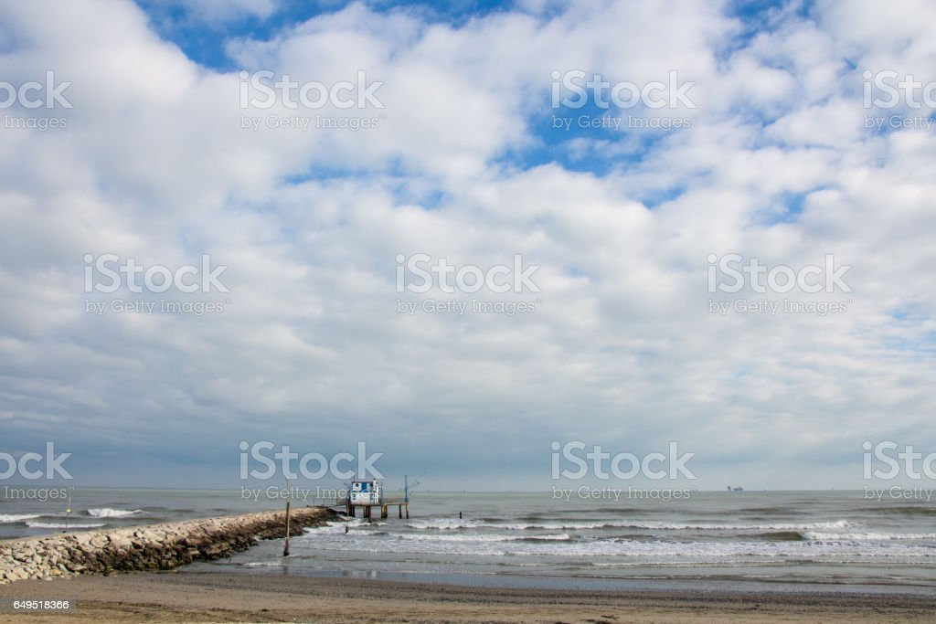 Traditional fishing house with net in Italy stock photo