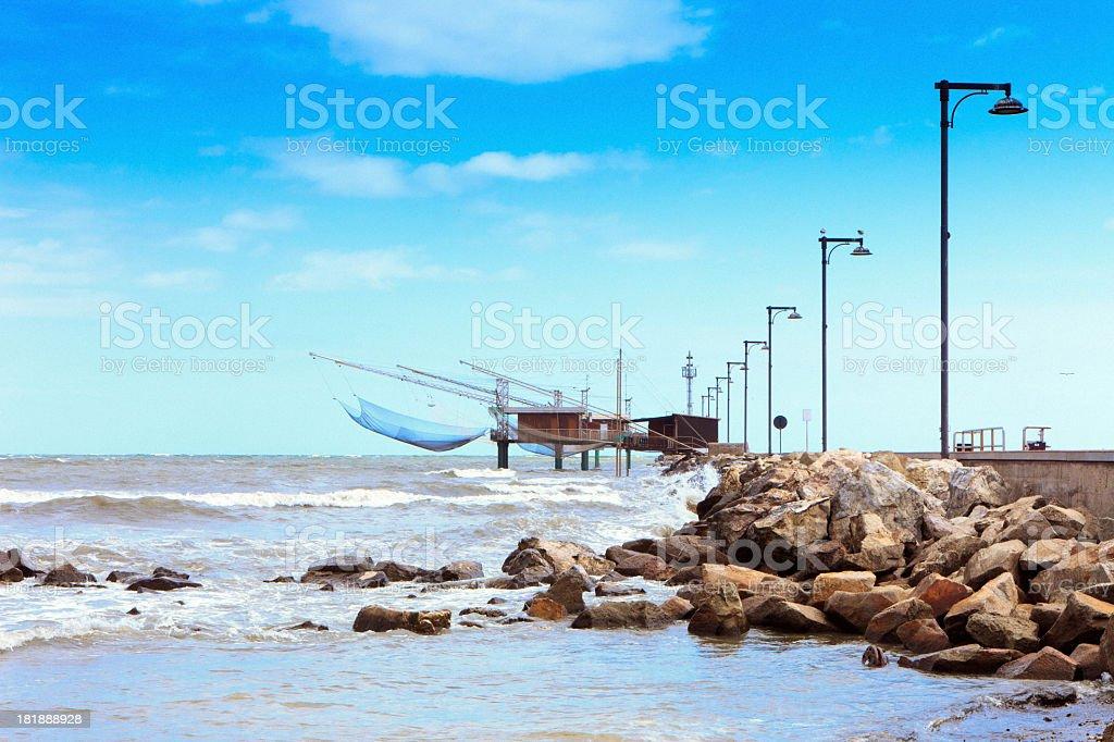 Traditional fishing shacks in Italy stock photo