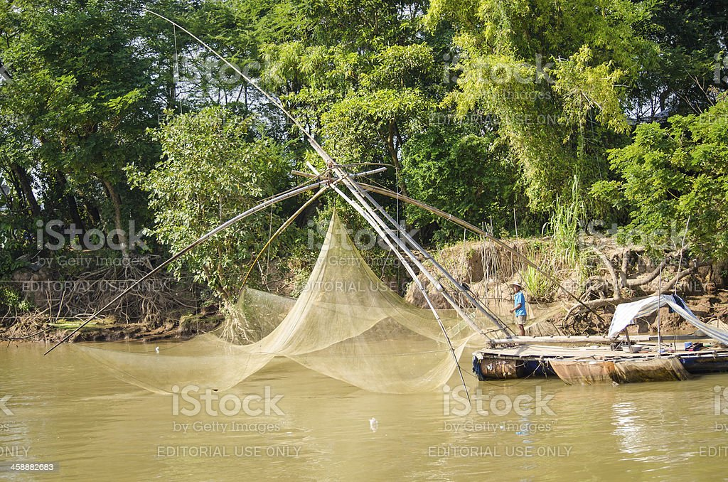 Traditional fishing with net in Vietnam royalty-free stock photo