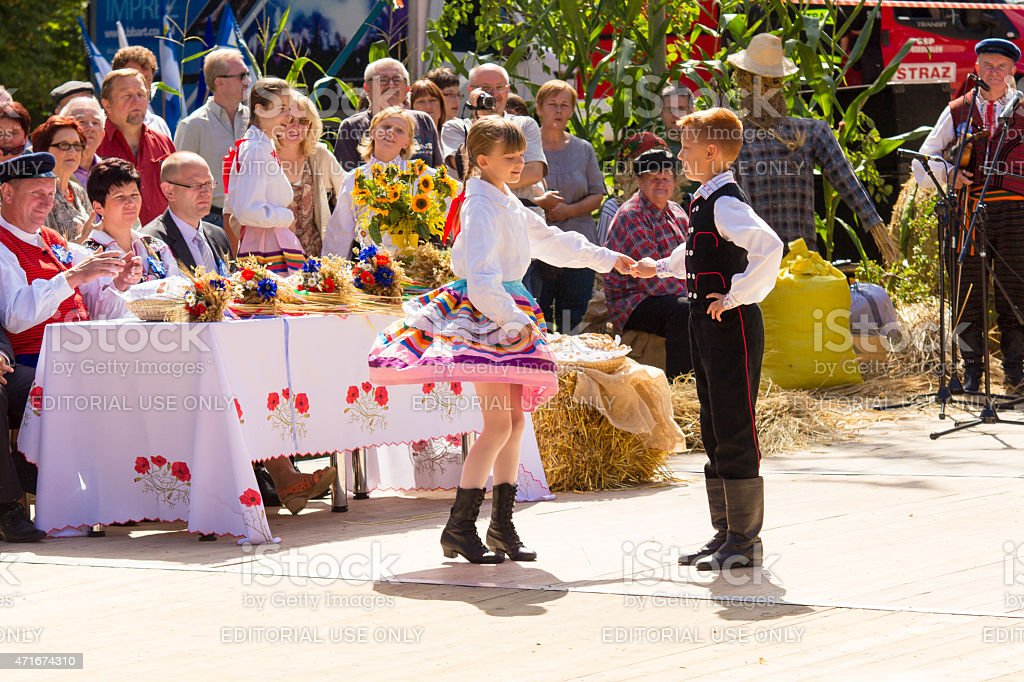 Traditional folk dancing during the harvest festival in Poland stock photo