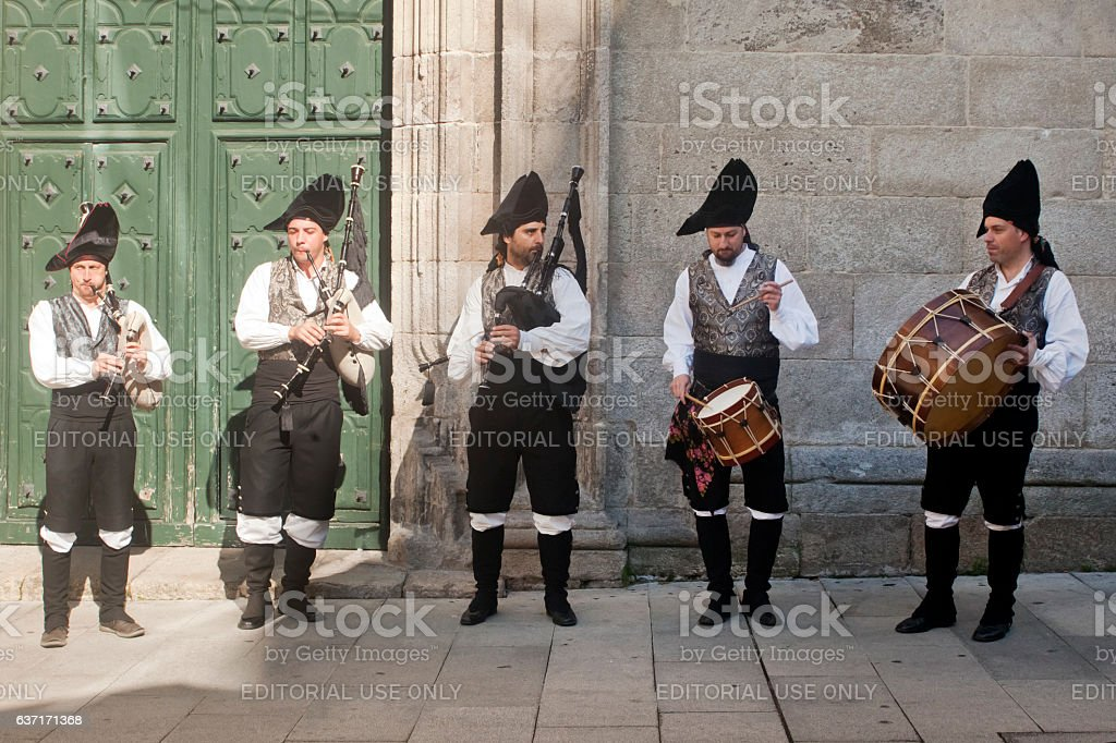 Traditional folk musicians playing in the street. stock photo