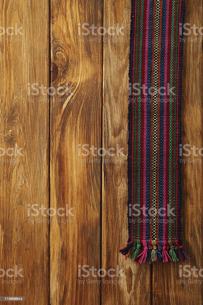 Traditional folklore textile texture on wood beckgronds royalty-free stock photo