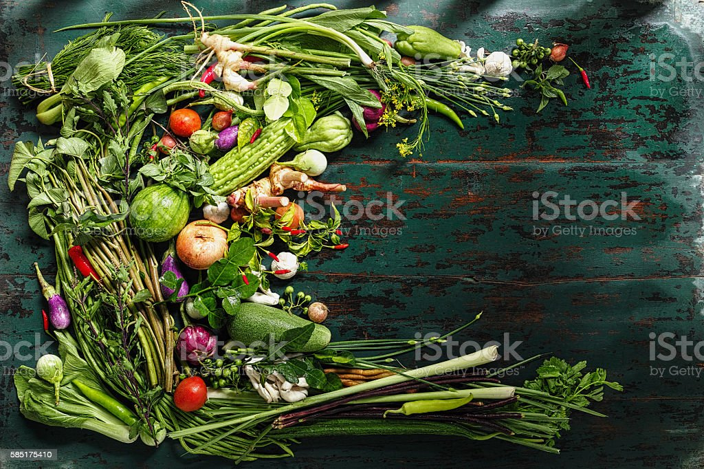 Traditional fresh Thai vegetables, herbs and spices on old table. stock photo