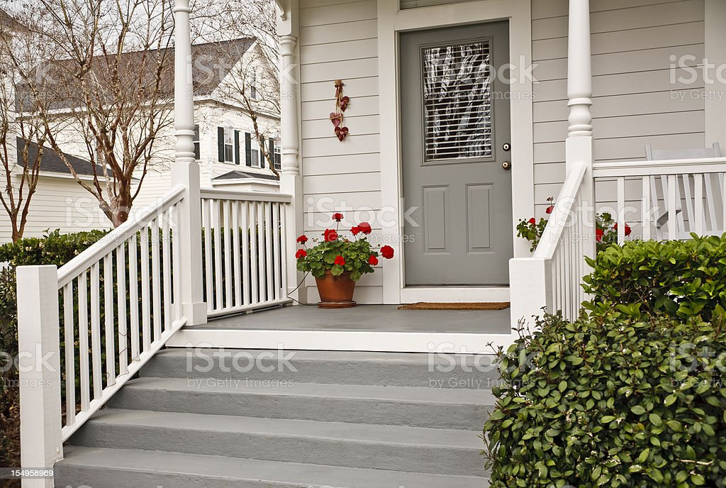 Traditional Front Porch with Geraniums stock photo