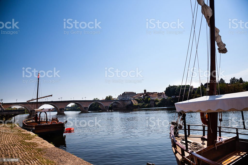 traditional gabarre boats at quayside Bergerac Dordogne France stock photo