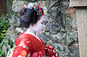 traditional geisha maiko girl at street of kyoto japan