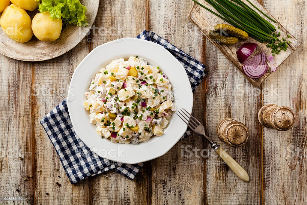 Traditional German potato salad with cucumber, onion and mayonna stock photo