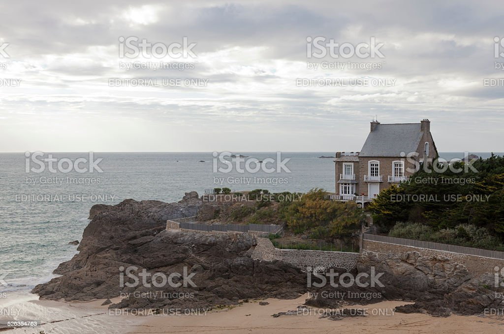 Traditional granite house on cliffs in Brittany stock photo