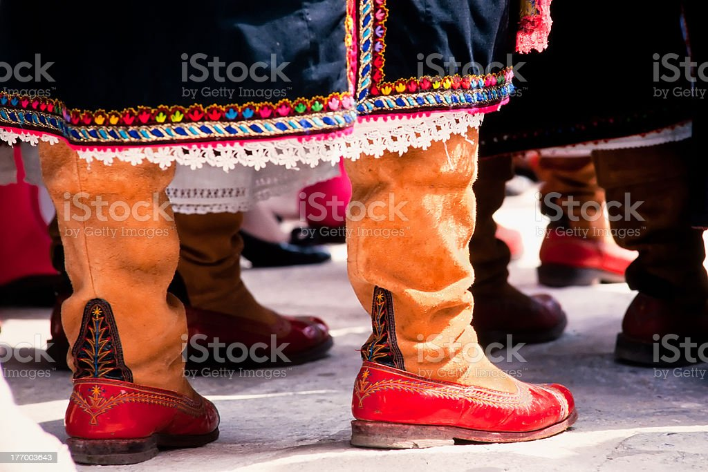 Traditional Greek cloths, dress and leather shoes royalty-free stock photo