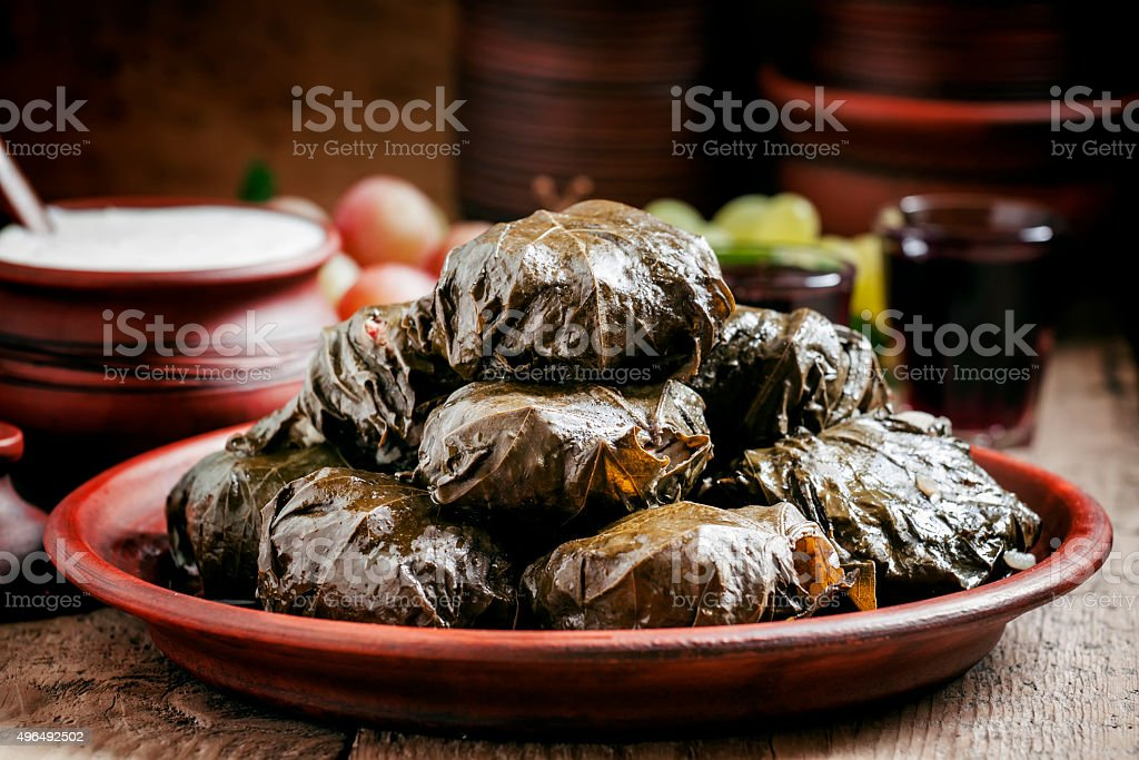 Traditional Greek dolma with meat in grape leaves stock photo
