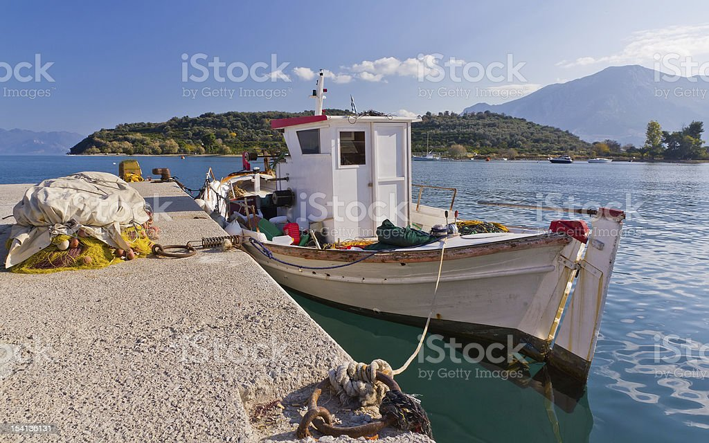 Traditional Greek fishing boat in Archaia Epidaurus harbor, Greece stock photo
