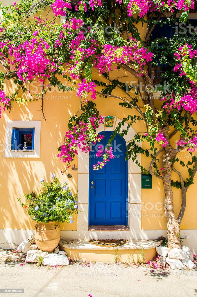 Traditional greek house with flowers in Assos, Kefalonia island, stock photo
