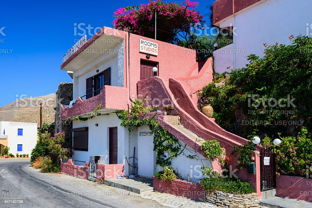 Traditional Greek stone house, decorated with  bougainvillea flowers stock photo