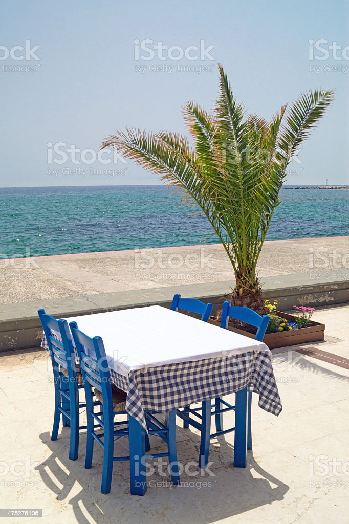 Traditional Greek table at the beach in Greece stock photo