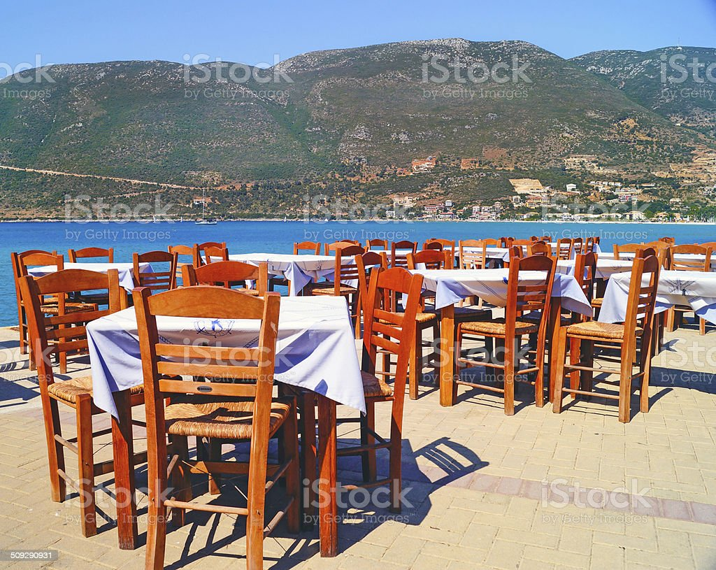 Traditional Greek tavern at the beach in Greece stock photo