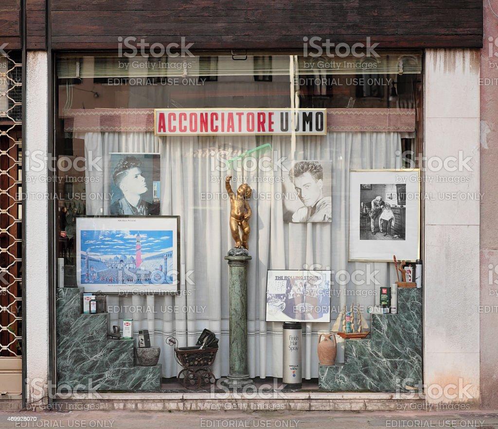 Traditional hairdresser shop window in Venezia, Italy stock photo