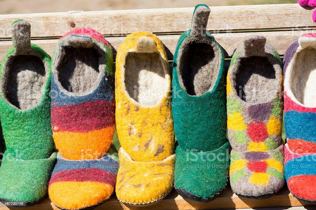 Traditional handmade saxon wool shoes from Viscri, Transylvania, Romania stock photo