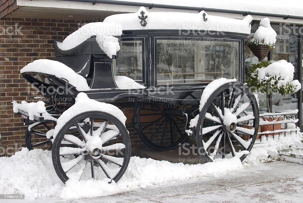 Traditional hearse in snow at Worthing. Sussex. England stock photo