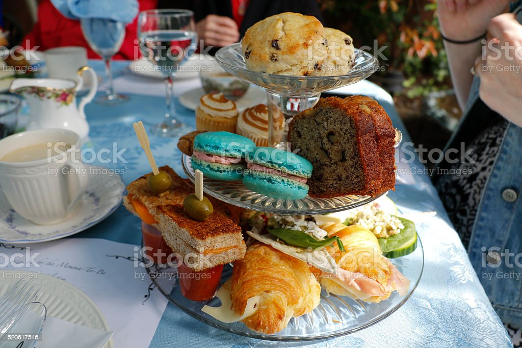 Traditional high tea baby shower served in the garden stock photo