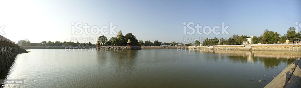 Traditional Hindu temple on lake in the city center, Madurai stock photo