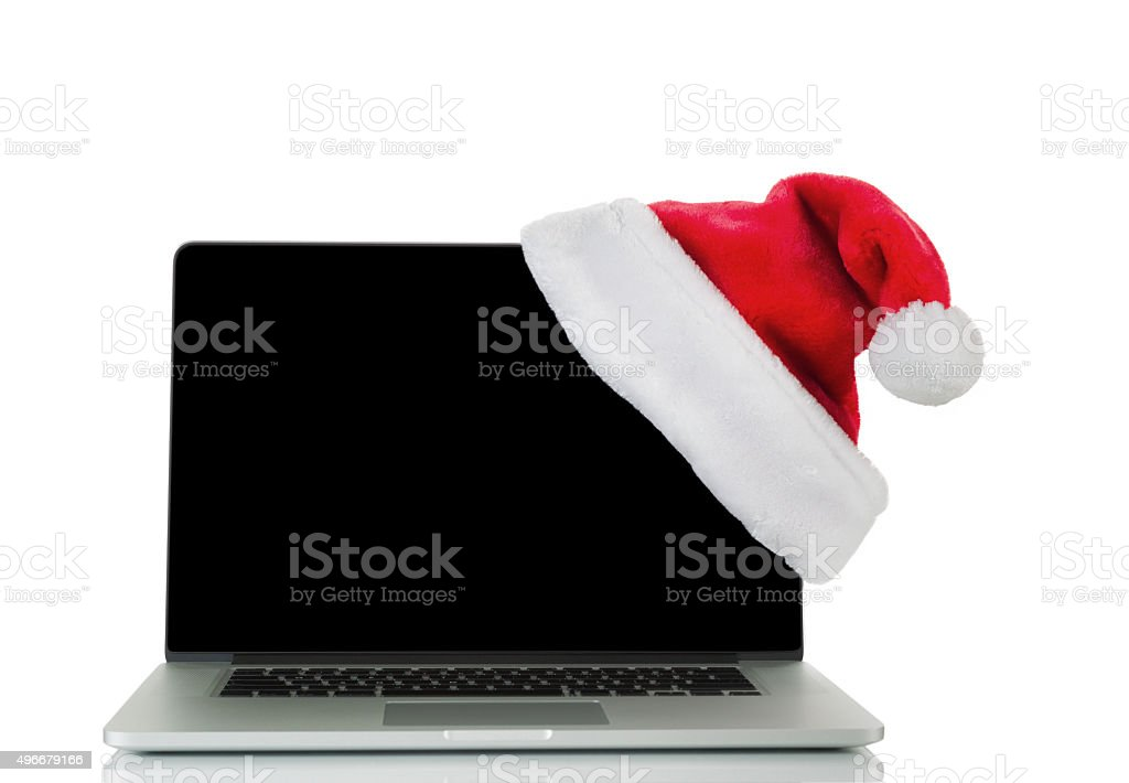 Traditional holiday Christmas hat and laptop computer isolated o stock photo