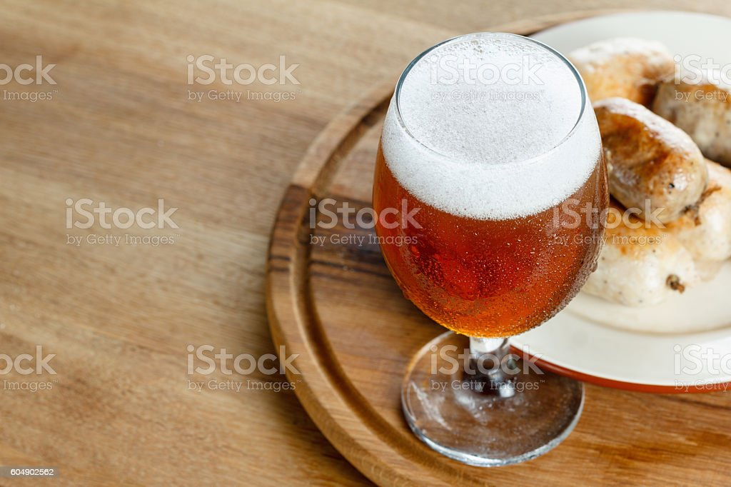 Traditional homemade sausage with beer on wooden table stock photo