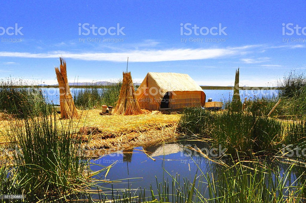 Traditional house in Uros Island, Titicaca Lake stock photo