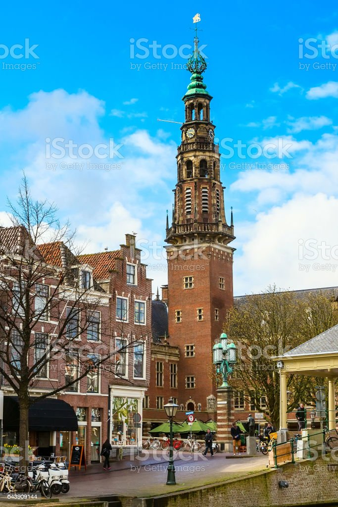 Traditional houses and church in downtown of Leiden, Netherlands stock photo