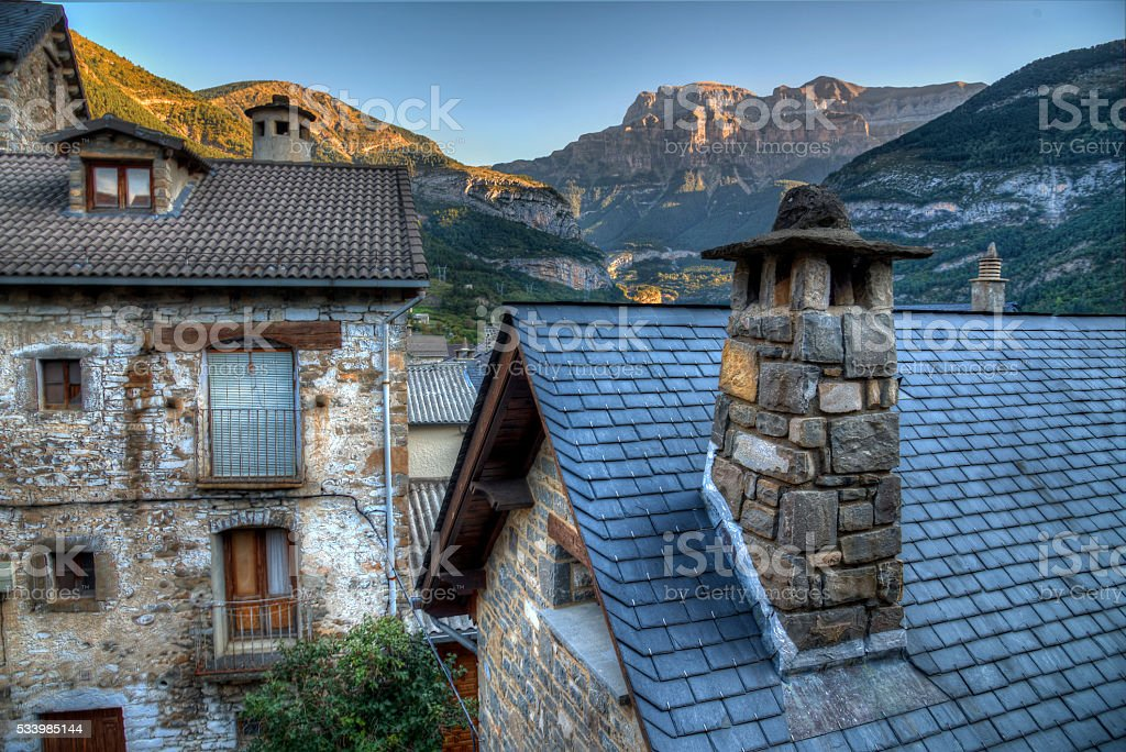 Traditional houses and Pyrenees, Torla, Spain stock photo
