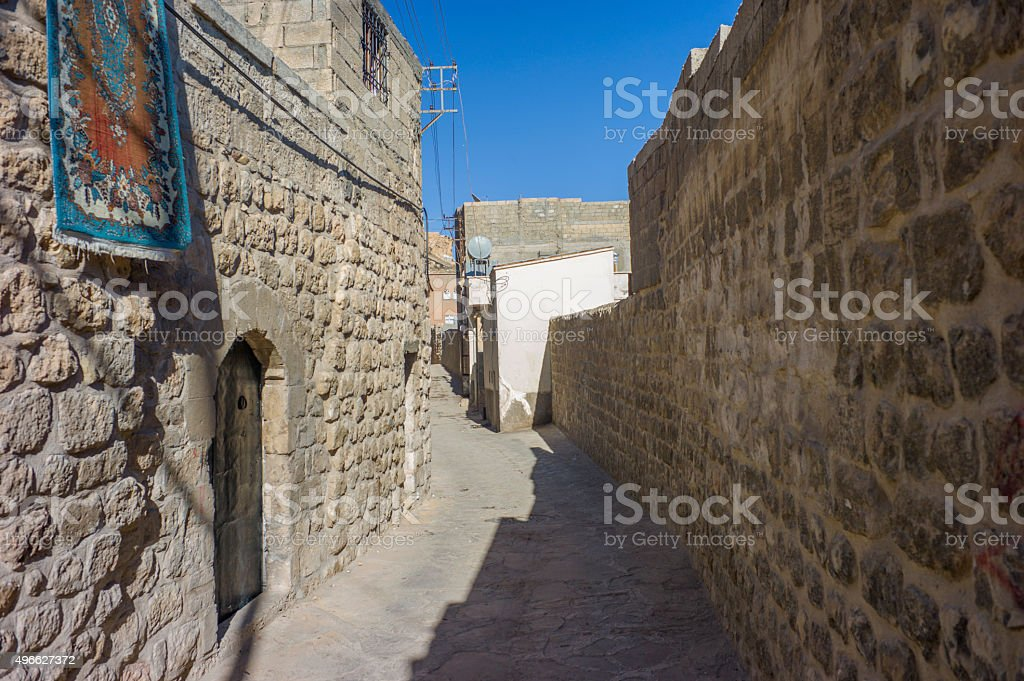 traditional houses at narrow street of middleeastern town mardin turkey stock photo