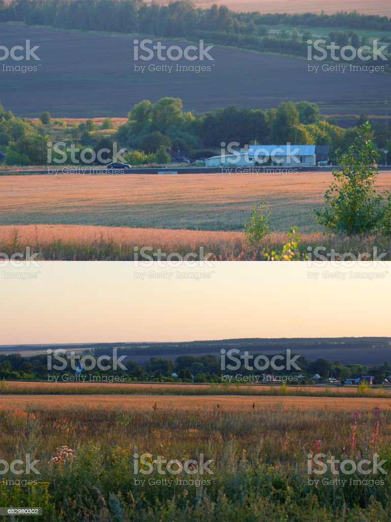 Traditional houses in the field stock photo