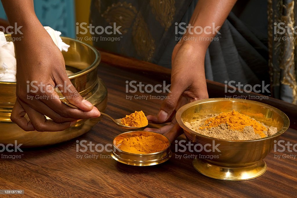 traditional indian ayurvedic  massage stock photo