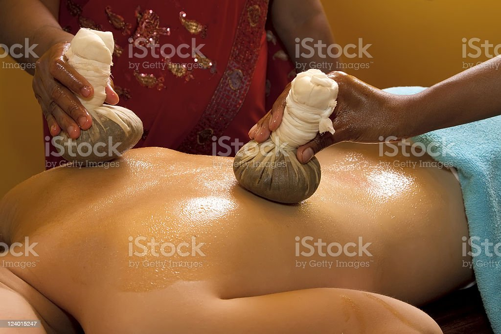 traditional indian ayurvedic oil massage royalty-free stock photo