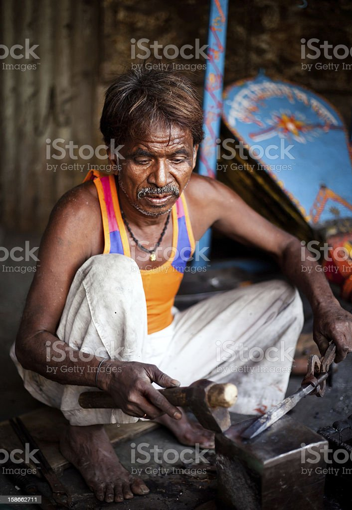 Traditional Indian Blacksmith at work royalty-free stock photo