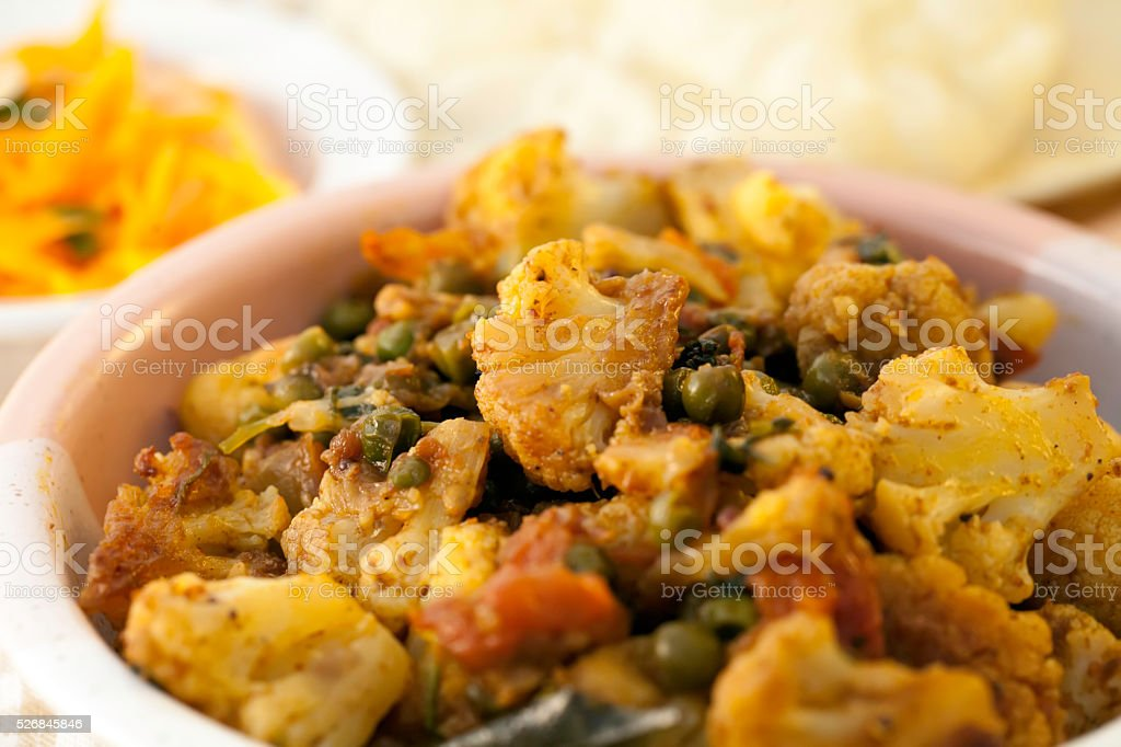 Traditional Indian Cauliflower and Pea Curry stock photo