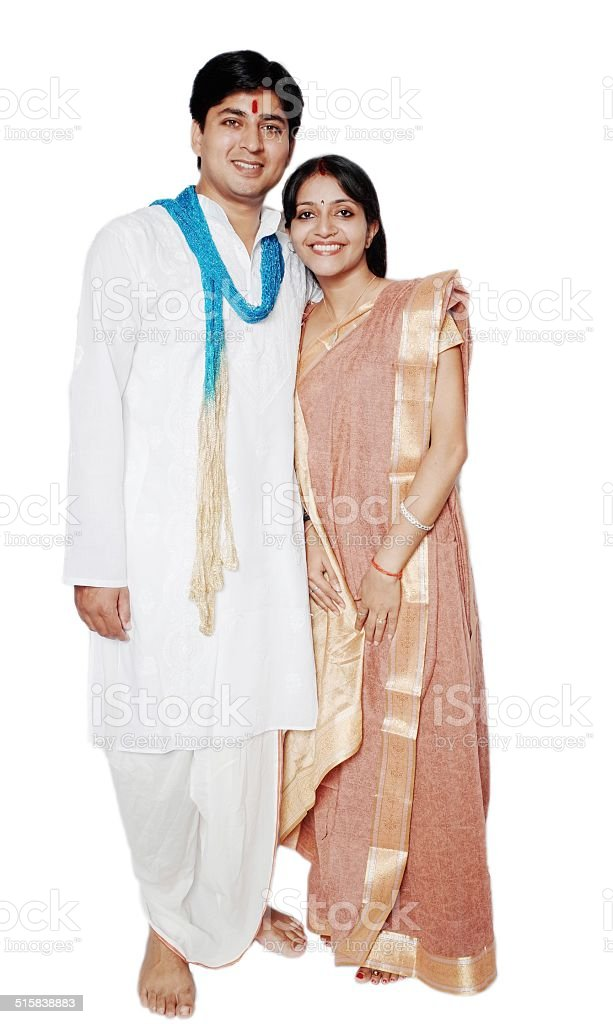 Traditional Indian couple smiling with their spouse. stock photo