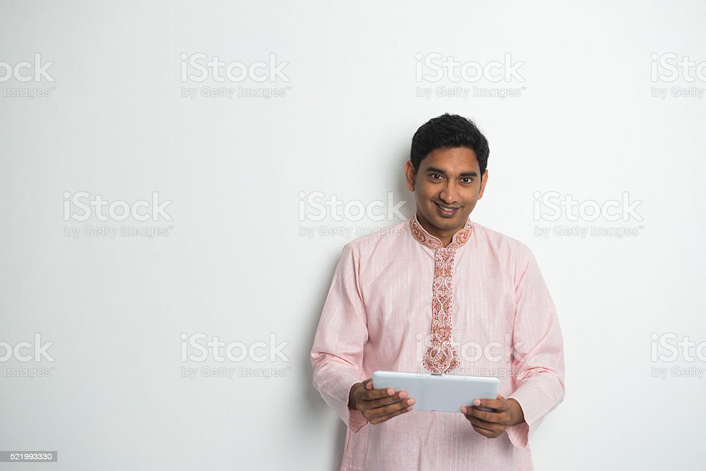 traditional indian male with tablet and plenty of copyspace stock photo