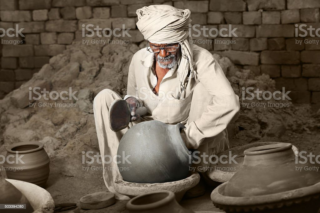 Traditional Indian potter making clay pot stock photo