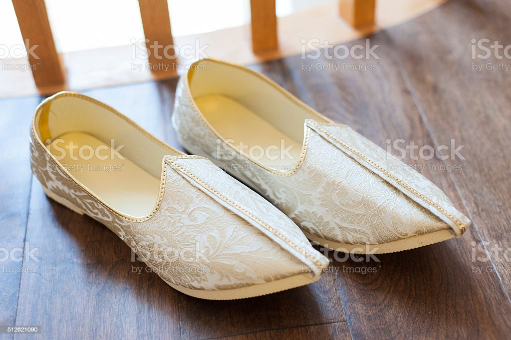 Traditional Indian wedding shoes stock photo