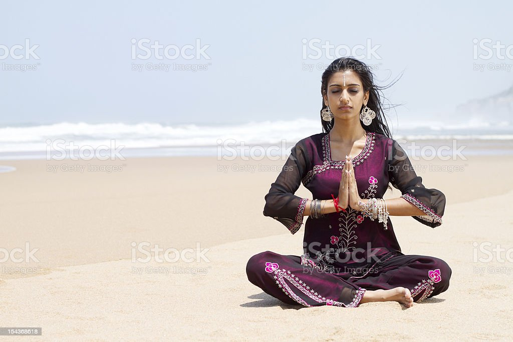 traditional indian woman beach yoga royalty-free stock photo