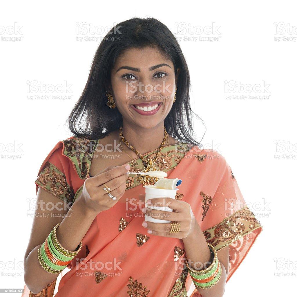 Traditional Indian woman eating yogurt royalty-free stock photo