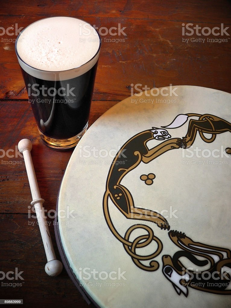 Traditional Irish Scene with Bodhran Drum and Pint Of Stout royalty-free stock photo